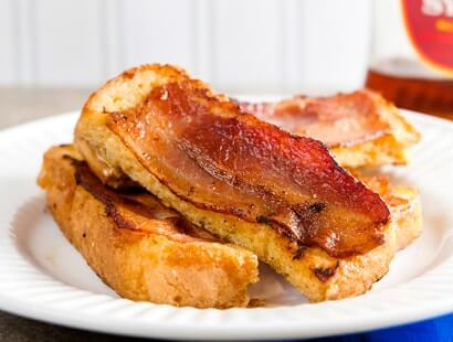 fully cooked bacon slice on french toast