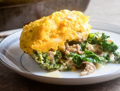 Sausage & Kale Breakfast Casserole with Biscuit Topping