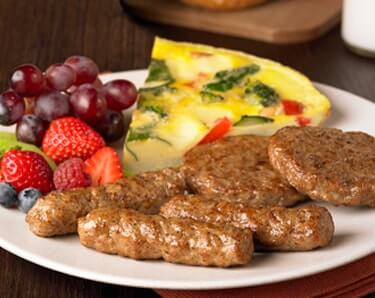 Plated Breakfast Sausage with Quiche and Fruit